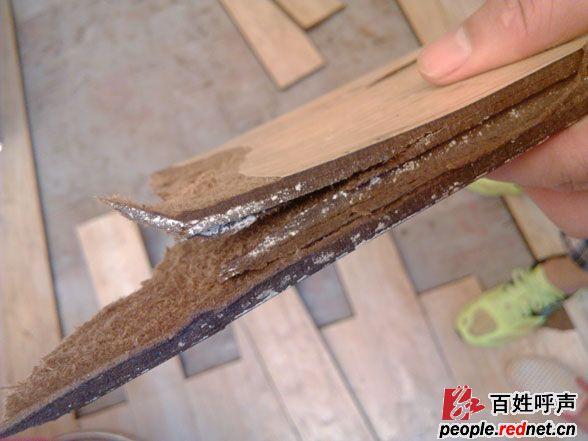 长沙第一湾卫生间未装地漏,漏水致木地板全毁(图)